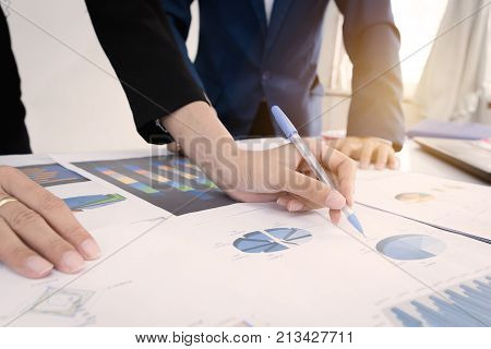 Business and finance investment concept. Businessman calculate about cost and doing finance at office Finance managers taskBusinessman recheck new plan financial graph data.