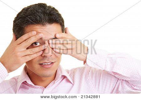 Peeking Through Fingers