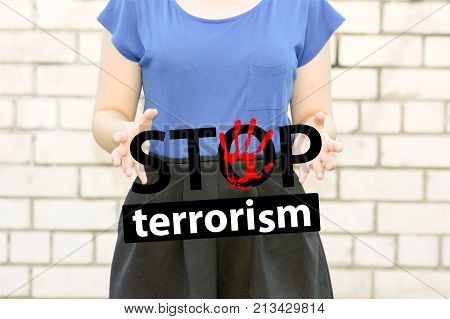 Stop Terrorism Concept. Girl On A Brick Wall