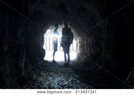blurred people in a dark tunnel for backgrounds