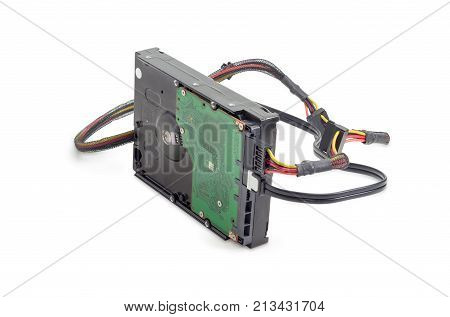 Hard disk drive for use in desktop computers and servers with connected power cable and data cable on a white background