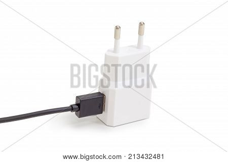 White AC adaptor for mobile phones battery charging with connected black cable compatible with USB on a light background