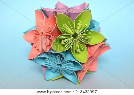 Origami kusudama flower ball on blue background
