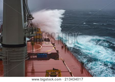 Severe storm in north Pacific. Dangerous wave hits a ship