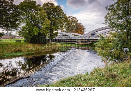 Pansport Bridge below River Lossie Weir, and Elgin Cathedral which is the new bridge and weir
