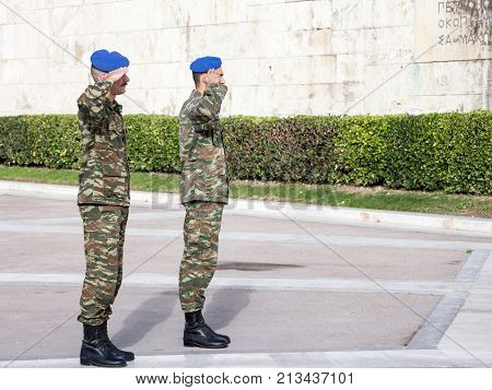 ATHENS GREECE - NOVEMBER 3 2017: Greek solider saluting the Greek presidential guard in front of the Greek parliament on Syntagma square. The Evzoni are one of the symbols of Greece
