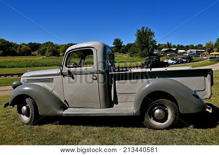 DALTON, MINNESOTA, Sept 8 2017: An old restored Ford pickup is parked near the railroad tracks at the annual Dalton Steam Threshers Reunion held the 2nd weekend of September when 1,000s attend.