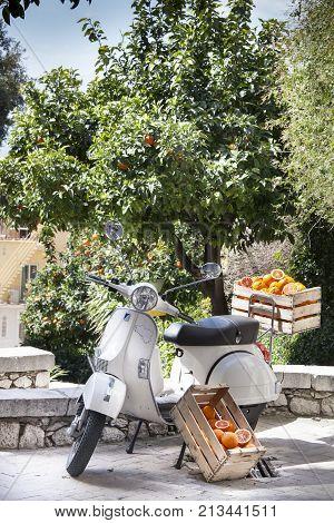 TAORMINA, ITALY. April 3, 2015: Oranges in the box. Ancient Italian motorcycle bike