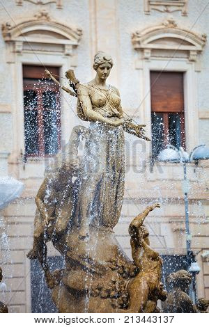 SYRACUSE, ITALY. April 3, 2015: Diana's fountain is a monumental fountain by Julius Muskets 1907 located in Piazza (Square) Archimede in Syracuse.