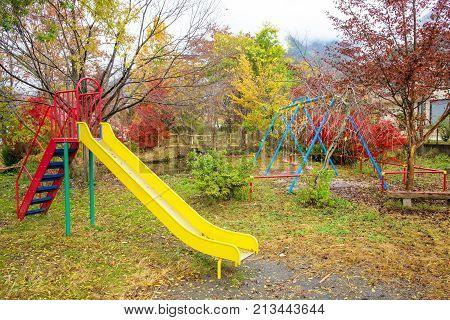Children Playground In Autumn Park