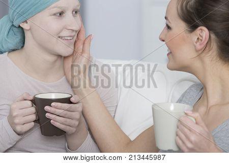 Woman Stroking Friend's Paleface