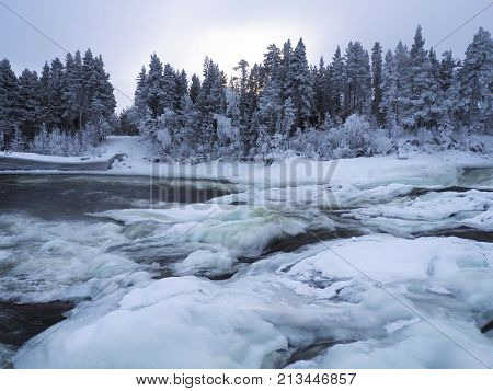Magic Winter waterfall Storforsen in the North oSweden