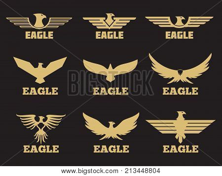 Gold heraldic eagles logo collection on black background. Vector eagle emblem silhouette, bird element icon of set illustration