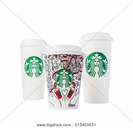 Chiang Mai Thailand- 11 November 2017 - 2 sizes Grande size of Starbucks Coffee paper cups in beautiful 2017 Christmas design and Venti size in white with Starbucks logo design are displayed on white background in Chiang Mai Thailand on November 11 2017