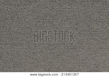 abstract macro texture of damp synthetic fabric for a background of beige color