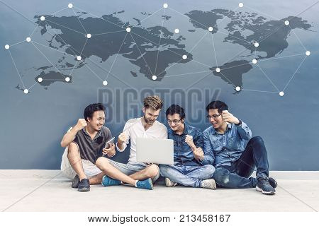 Group Of Asian and Multiethnic Business people with casual suit using each technology equipment brainstorming with colleague in happy and celebrate action at the outdoor people business group concept