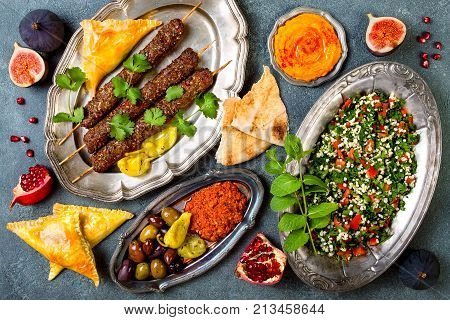 Middle Eastern traditional dinner. Authentic arab cuisine. Meze party food. Top view flat lay overhead