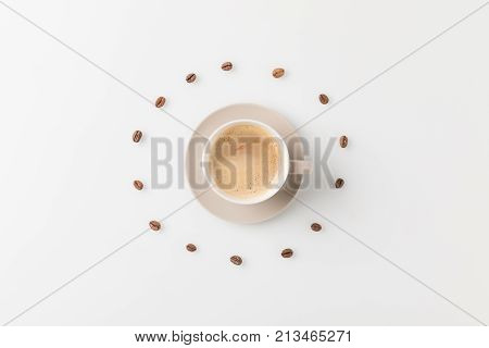 Coffee Cup Surrounded With Beans