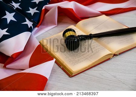 Wooden gavel. usa legal concept, judge wooden gavel and legal book with usa flag.
