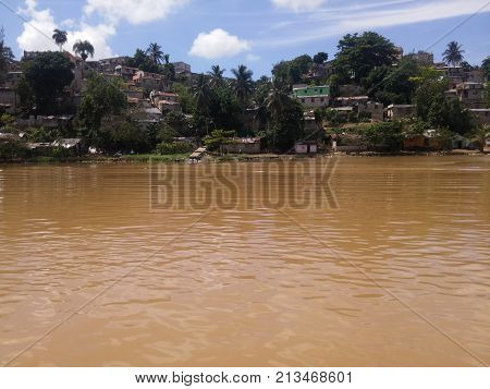 Precarious houses on the banks of the Ozama River in Santo Domingo city , Dominican Republic