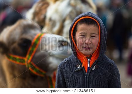 OLGIY, MONGOLIA - SEP 30, 2017: Unidentified Mongolian child during annual national competition with birds of prey