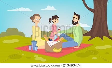 Family at picnic. Isolated parents and daughter on blanket withfood in the park on grass.