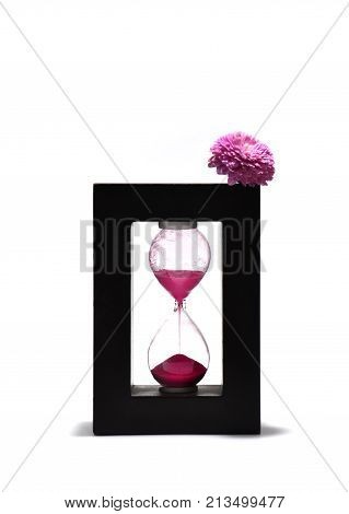Hourglass with pink flowers on a white background