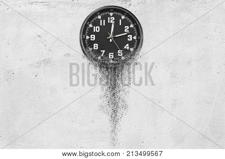 3d illustration of Classic clock on white concrete background disintegrates in small parts and flowing away. Time flying concept