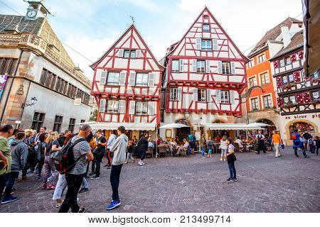 COLMAR, FRANCE - July 26, 2017: Street view on the beautiful old buildings with people walking in the famous tourist town Colmar in Alsace region, France