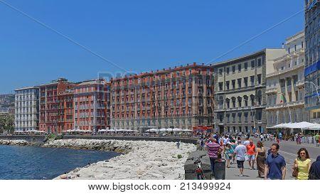 NAPLES ITALY - JUNE 22 2014: Tourists Walking at Via Partenope Promenade in Napoli Italy.