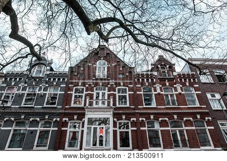Old facade of a two-story building in Rotterdam, Belgium
