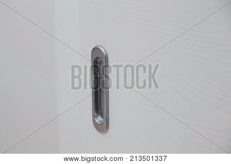 Closeup handle. Modern door handle tilt view.