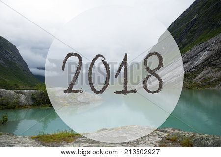 Text 2018 For Happy New Year Greetings. Lake With Mountains In Norway. Cloudy Sky. Peaceful Scenery, Landscape With Rocks And Grass. Greeting Card