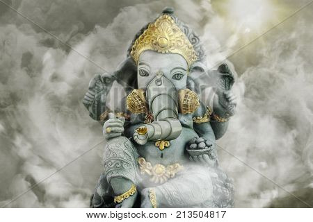 3D Rendering of Indian elephant sculpture surrounded by smoggy background with sun breaking through