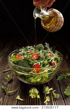 In a vegetable salad a thin stream of olive oil is poured