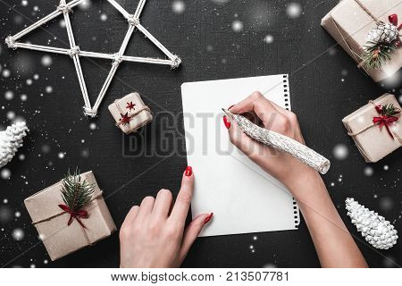 Christmas card. When you think about what gifts you want from Santa Claus. Xmas ambience is complemented by a multitude of surrounding gifts and snowflakes