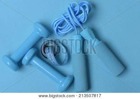 Fit Shape And Sport Concept. Jump Rope, Tape And Barbells