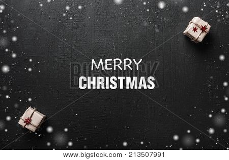 Christmas card. With space for a greeting message for loved ones and close ones. Xmas ambience is filled with gifts and snowflakes around