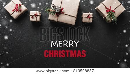 Christmas card. Symmetrically arranged gifts at the top of the image. Christmas greetings message. Xmas ambience is complemented by gorgeous gifts and snowflakes