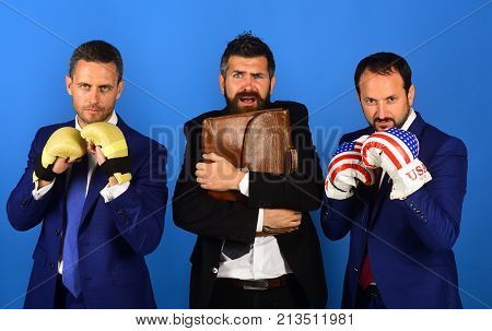 Man With Beard And Frightened Face Holds Tight Briefcase.