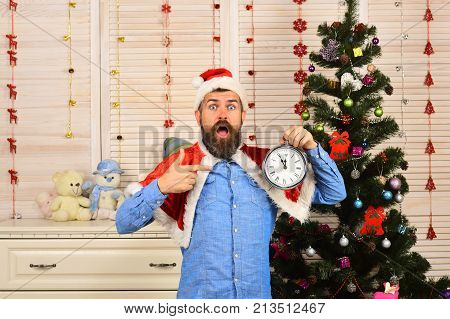 Santa Claus With Surprised Face With Christmas Tree On Background