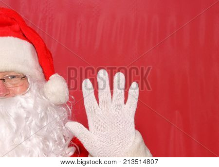 Santa Claus. Santa Claus Head Shot in front of a Red Background.