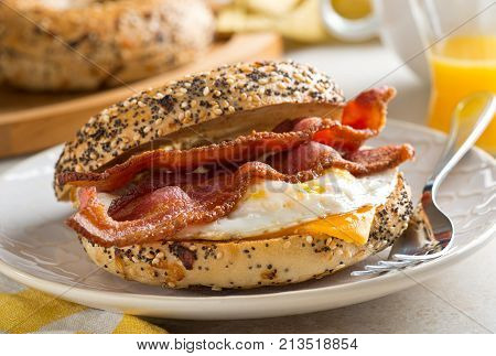 A delicios breakfast bagel with bacon egg and cheese.