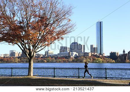 Boston City, Massachusetts - Nov 5, 2013: A jogger running along the Charles River rank in the downtown area of Boston City, on Nov 5, 2013.