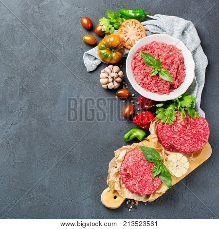 Homemade Raw Organic Minced Beef Meat Burger Cutlet And Vegetables