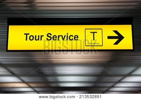 sign tour service at the airport with arrow for direction to tour counter service for tourist