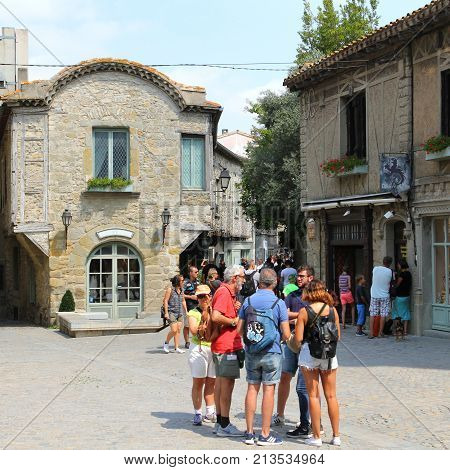 Carcassonne, Languedoc-roussillon, France - August 24 2017: Group Of Tourists Talking While Visiting