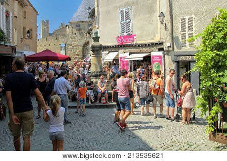 Carcassonne, Languedoc-roussillon, France - August 24 2017: Tourists Relaxing In The Sunshine Along