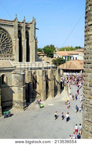 Carcassonne, Languedoc-roussillon, France - August 24 2017: Tourists Around The Basilique Saint Naza