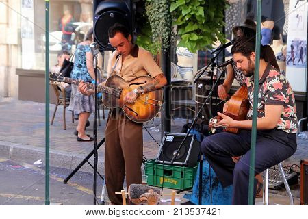 Sete, Herault, France  - Aug 21 2017: Trio Of Musicians With Guitars And Singing At An Open Air Even